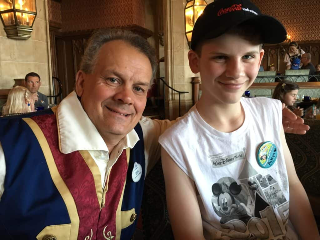 Don, our server, with Aaryn at Cinderella's Royal Table breakfast ~ photo taken by T.M. Brown