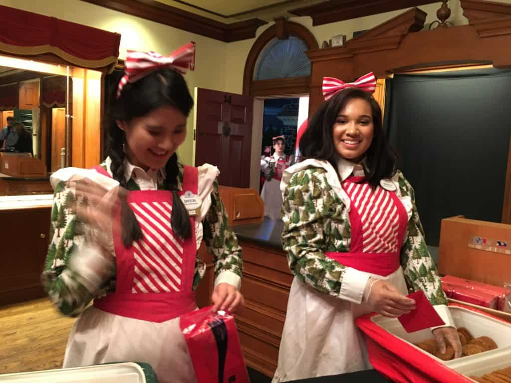 Cast Members distributing molasses cookies and eggnog ~ photo taken by T.M. Brown