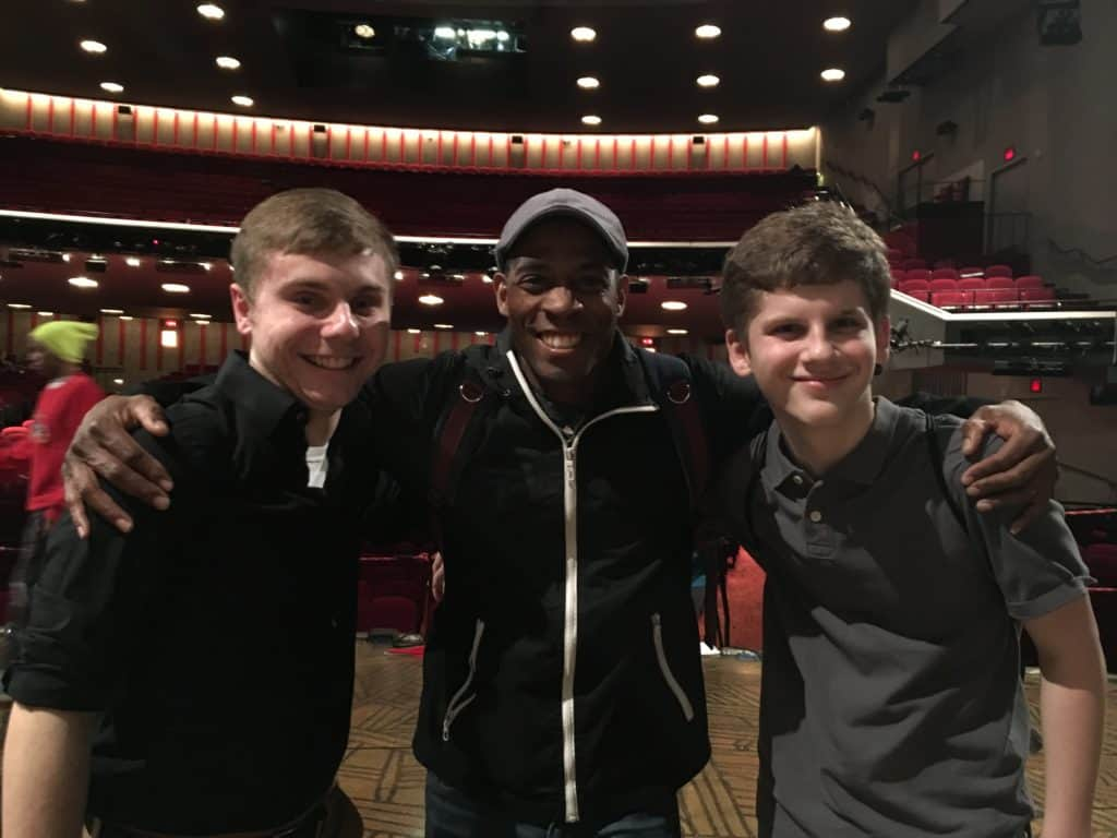 The boys meeting Matt, a member of The Lion King team