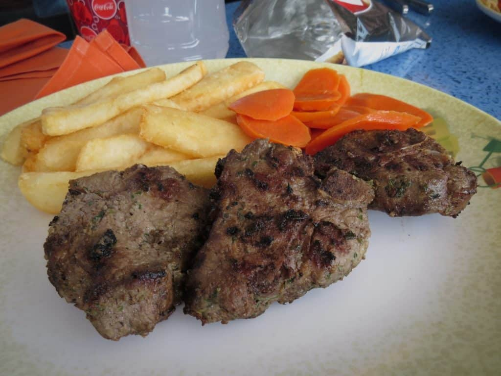 Managing Food Allergies on a Disney Cruise -plate of lamb, french fries and carrot coins