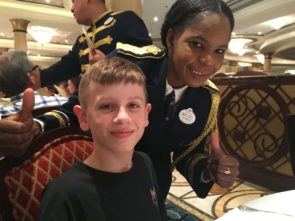 Managing Food Allergies on a Disney Cruise - Our server with our son at dinner on Disney Dream