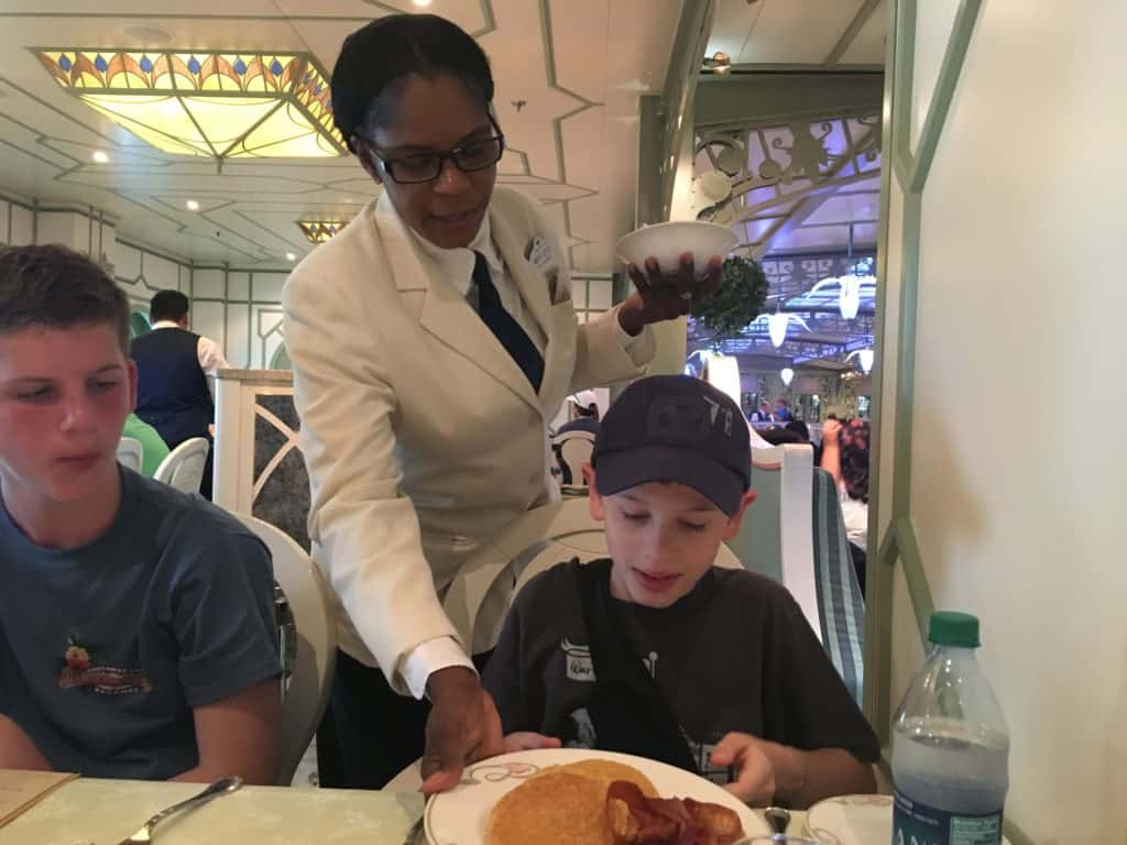 Managing Food Allergies on a Disney Cruise ~ Server bringing breakfast to a child