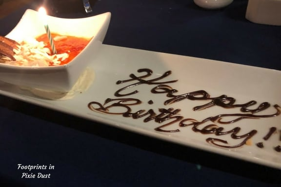 Narcoossee's coconut-chocolate creme brulee dessert with Happy Birthday in chocolate