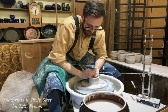 A potter at Silver Dollar City making cups / bowls on his potter's wheel
