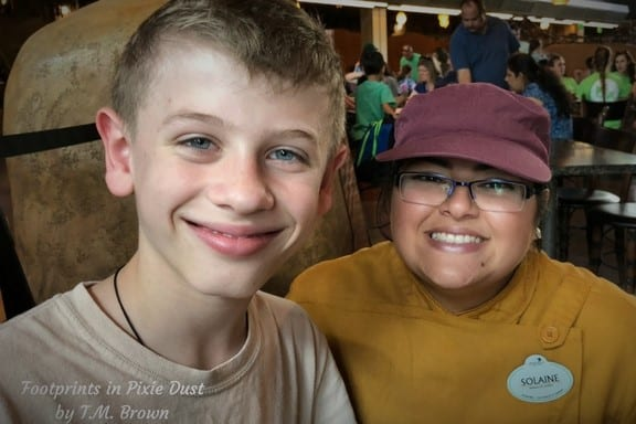 Young boy with a Cast Member at Satu'li Canteen at Disney's Animal Kingdom Park
