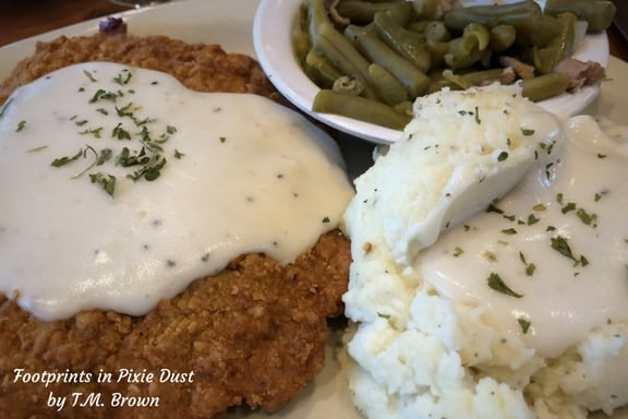 Country-Fried Steak with mashed potatoes and green beans at Fall Creek Steak & Catfish House