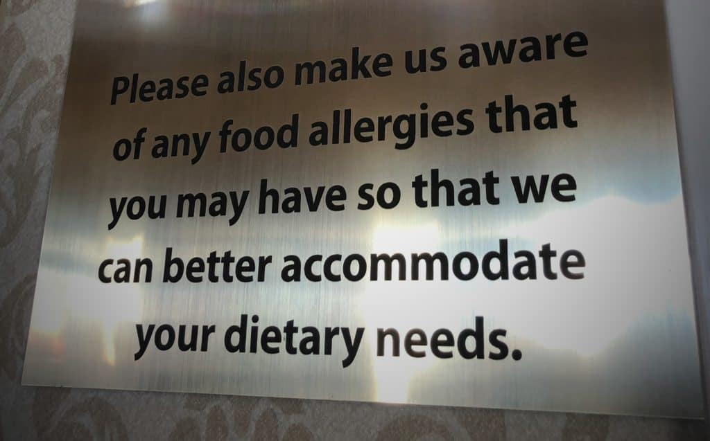 Food allergy sign in the lobby of Dolly Parton's Stampede Dinner Attraction in Branson
