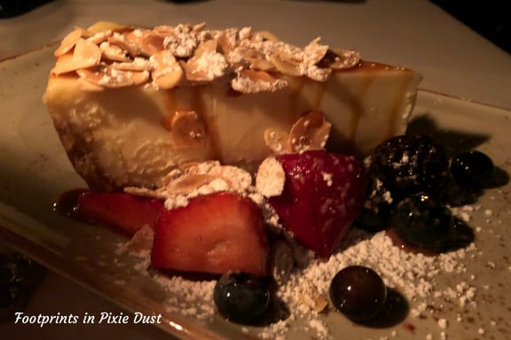 Cheesecake with caramel sauce, fruit and slivered almonds at San Angel Inn