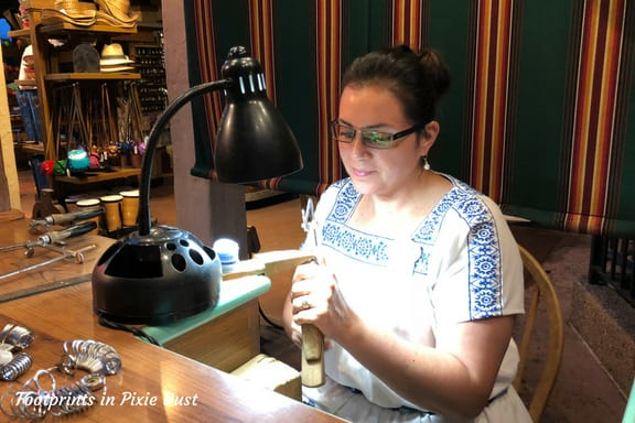 Cast Member making jewelry in Mexico Pavilion at Epcot