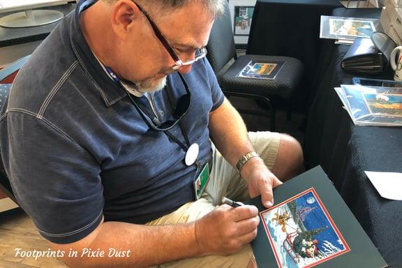 David E. Doss signing our print ~ Photo credit: Tina M. Brown