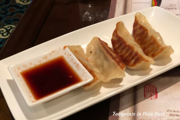 Plate of potstickers and soy sauce