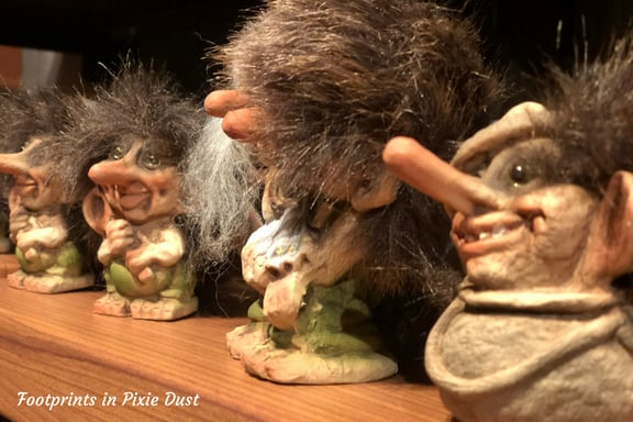 Troll figurines on shelf at Norway Pavilion in Epcot