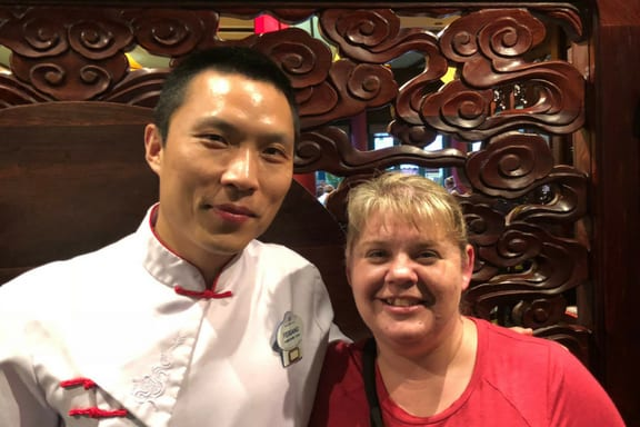 Guest and Cast Member at Nine Dragons in Epcot