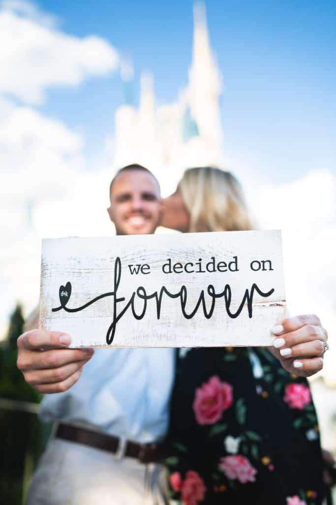Magic Kingdom engagement: She said YES! ~ Photo courtesy of Katie & Dustin