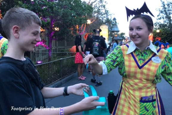 Receiving A Teal Token at Mickey's Not-So-Scary Halloween Party ~ Photo credit: Tina M. Brown