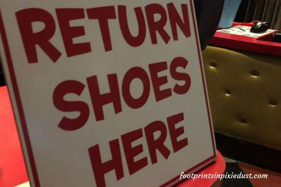 Return Shoes Here sign ~ Photo credit: Tina M. Brown