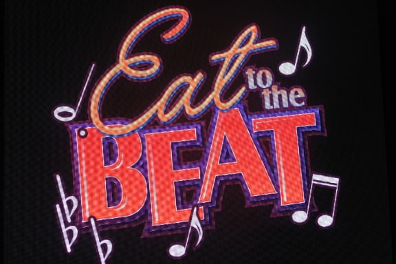 Eat to the Beat sign at American Gardens Theater