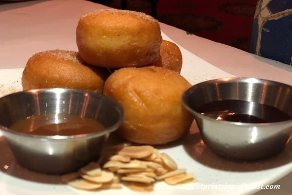 Warm beignets with chocolate and caramel sauces at Restaurant Marrakesh